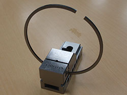 Piston ring secured in a fixture